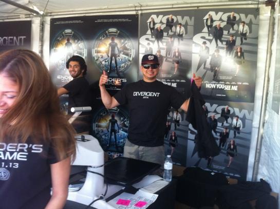 Summit representative pressing T-shirts for fand